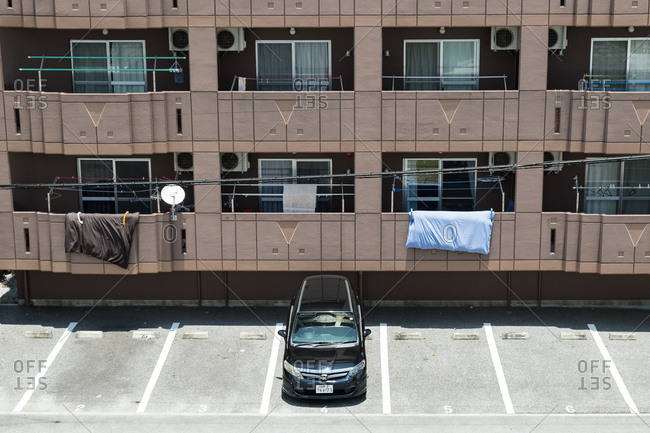 Okinawa, Japan - May 29, 2017: Car in parking lot by building