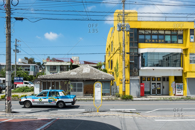 Okinawa, Japan - May 29, 2017: Taxi driving through residential street