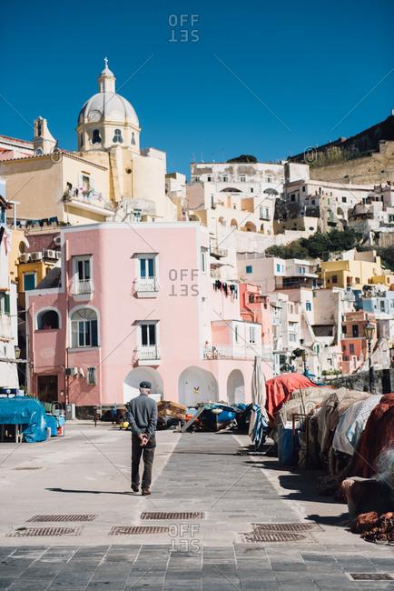 Man walking in Procida, Italy