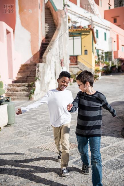Boys walking in Procida, Italy