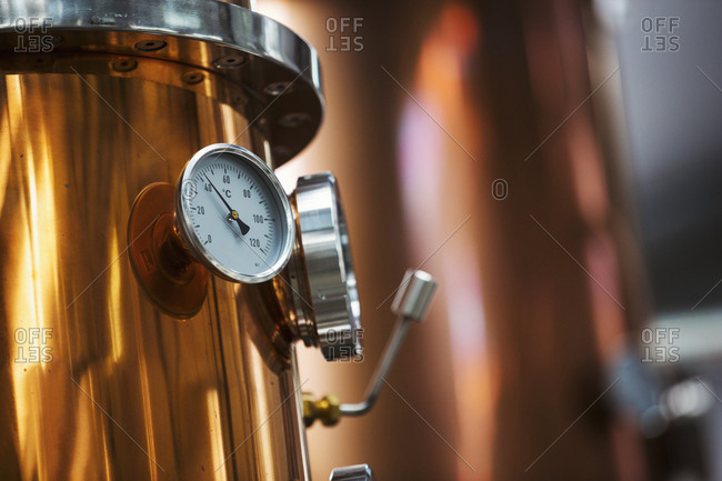 Close up of a gauge on a copper brew kettle or fermentation chamber