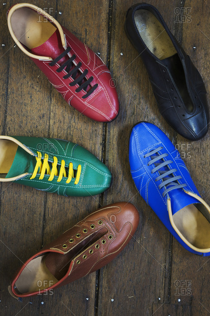 High angle view of colorful leather shoes in a shoemaker's workshop
