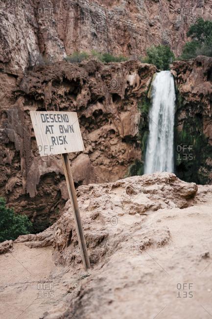 Warning sign at waterfall in Grand Canyon National Park