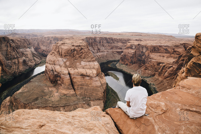 Young man admiring the view from above at Colorado River