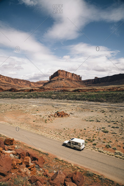 High angle view of motorhome on road with mountains in background at Moab