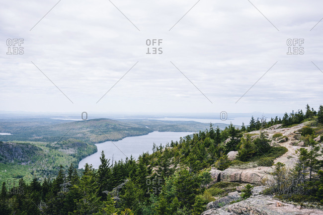 Atlantic Ocean seen from mountain at Acadia National Park against sky