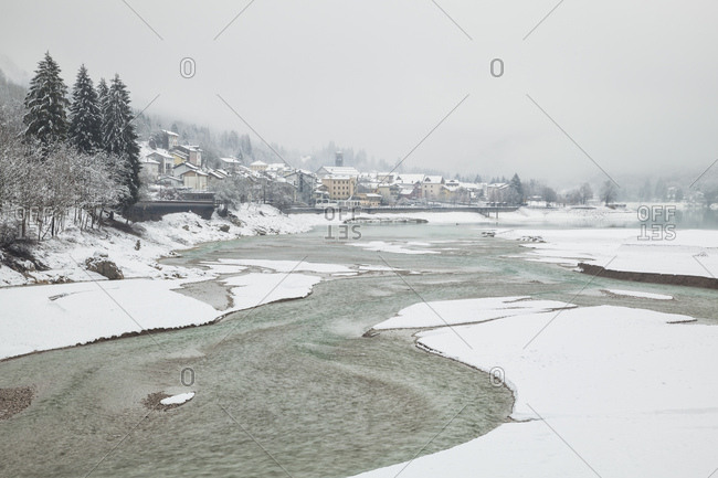 Winter landscape of Barcis, a very small tourist village nestled at the foothills of the Dolomiti Friulane Natural Park on the shores of Lago di Barcis (Lake Barcis), Unesco World Heritage, Italy, Pordenone district, Friuli Venezia Giulia, Friuli