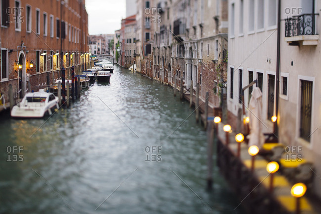 Tilt shift image of a canal in Venice with bokeh lights