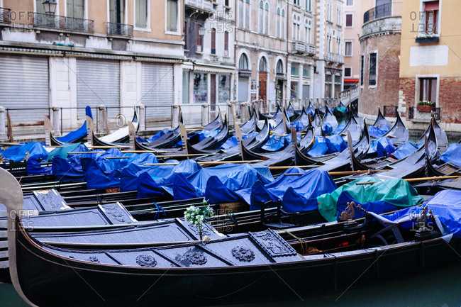 Group of gondolas parked for the night in Venice Italy