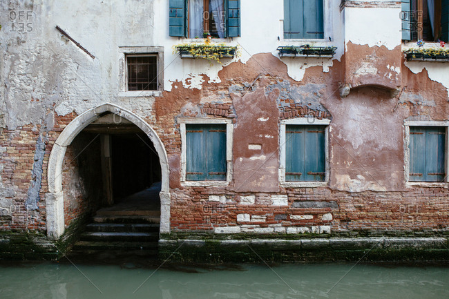 Door and windows of a Venice home on a canal