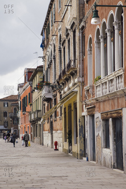 People walking and shopping on a street in Venice Italy