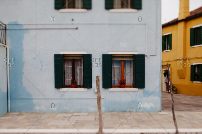 Tilt shift of colorful houses on a street in Burano Italy