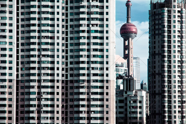 Shanghai, China - September 24, 2010: View of Oriental Pearl Tower between tall buildings in Shanghai
