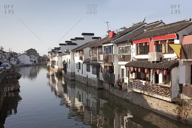 Suzhou, China - November 24, 2009: Waterfront homes in Suzhou city