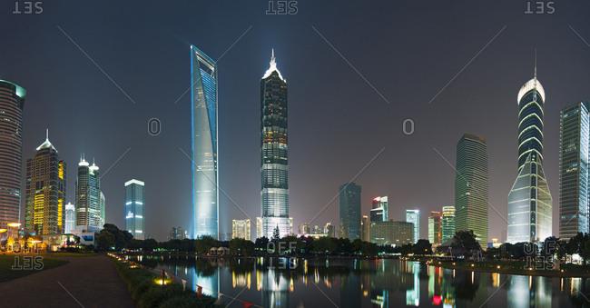 Shanghai, China - October 5, 2010: View of Shanghai on the Huangpu River illuminated at night