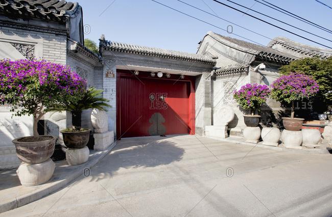Beijing, China - July 30, 2011: Traditional hutong house red door in Beijing