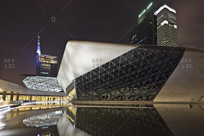 Guangzhou, China - June 18, 2010: Guangzhou opera house illuminated at night and reflecting in water