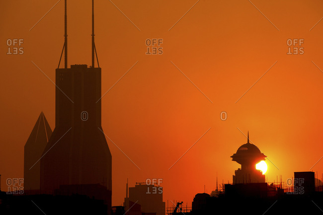 Sunset behind buildings in Shanghai, China