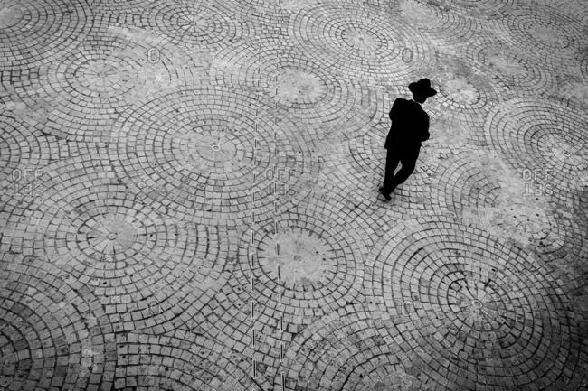 A Jewish man is walking in the city of Jerusalem