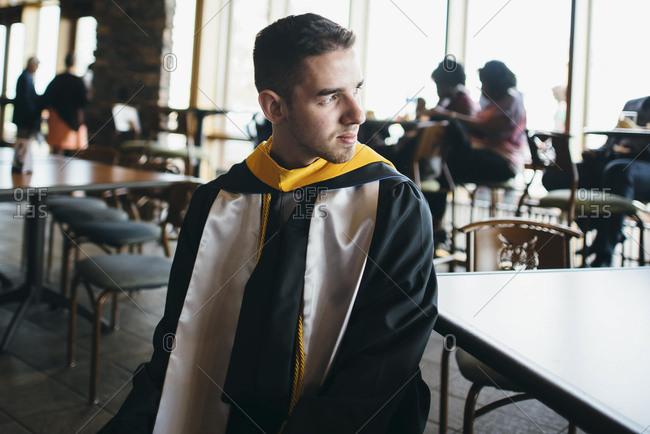College graduate looking away