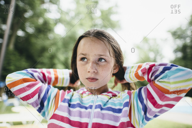 Girl with wet hair in a striped sweatshirt