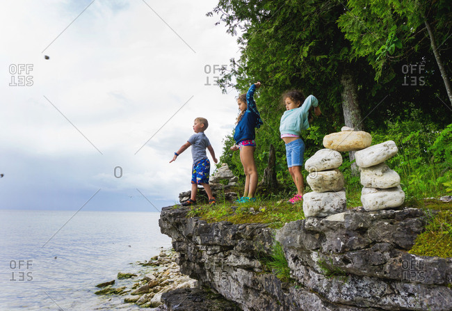 Three children looking out at Lake Michigan in Wisconsin