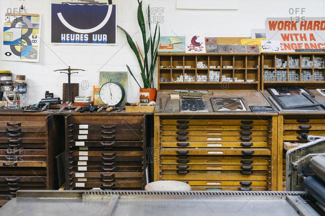 Antwerp, Belgium - May 29, 2017: Workshop with several desks and drawers in the Kaastar Print Workshop