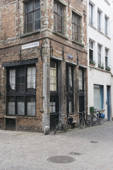 Antwerp, Belgium - May 31, 2017: Bikes parked beside brick building