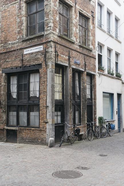 Antwerp, Belgium - May 31, 2017: Bikes parked beside brick building
