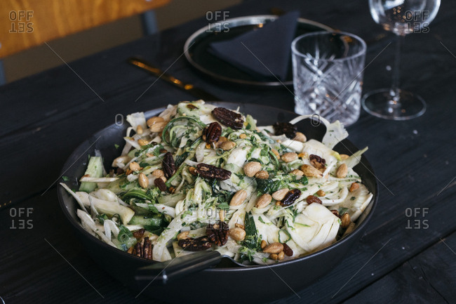 Salad with nuts served in a restaurant