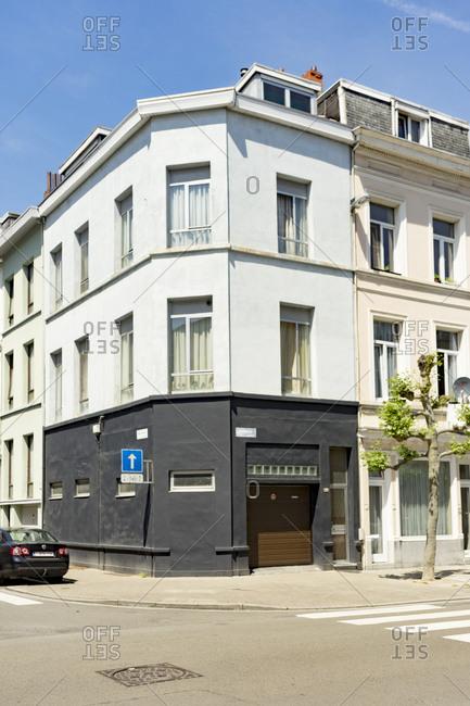 Antwerp, Belgium - June 1, 2017: Exterior of apartment buildings with a garage in Antwerp, Belgium
