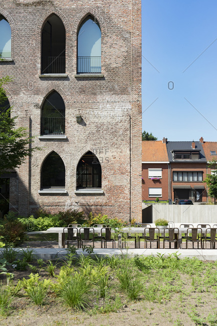 Patio table and chairs in courtyard of Kanaal, a place designed by Alex Vervordt in Antwerp, Belgium