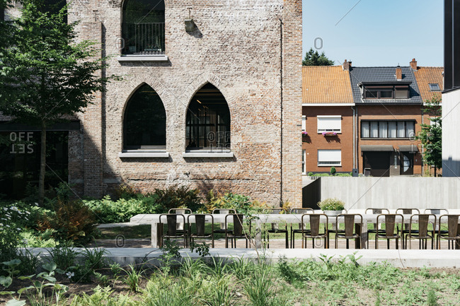 Table and chairs in courtyard of Kanaal, a place designed by Alex Vervordt in Antwerp, Belgium