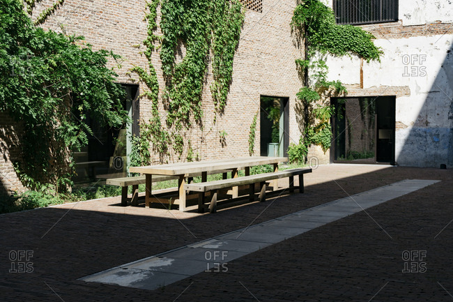Patio table in courtyard of Kanaal, a place designed by Alex Vervordt in Antwerp, Belgium