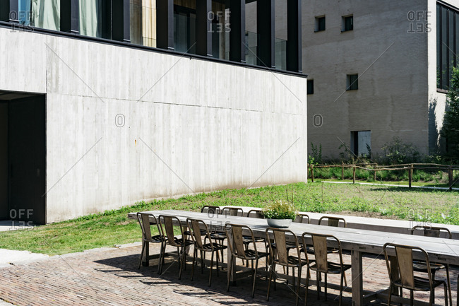 Table and chairs on patio of Kanaal, a place designed by Alex Vervordt in Antwerp, Belgium