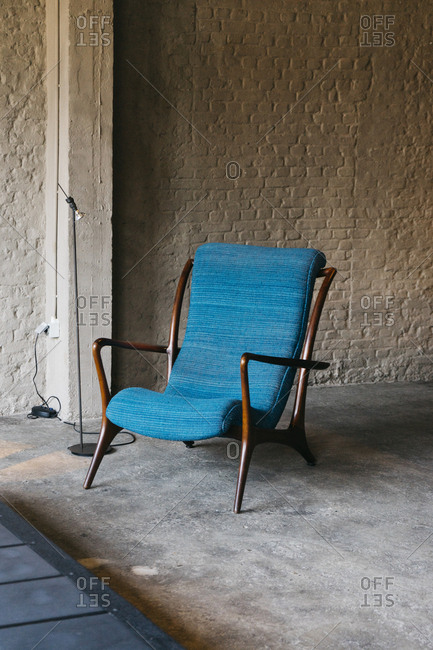 Wooden chair with blue cushion