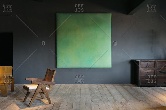 Antwerp, Belgium - June 2, 2017: Green painting on wall in home in Kanaal development in Antwerp, Belgium