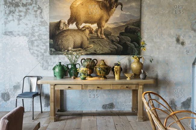 Antwerp, Belgium - June 2, 2017: Sheep artwork above table filled with vases