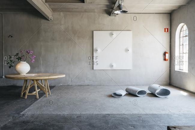 Antwerp, Belgium - June 2, 2017: Interior of home in Kanaal development in Antwerp, Belgium with a wooden table holding a vase