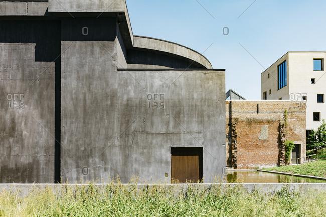 Stone exterior of building in Kanaal, a place designed by Alex Vervordt in Antwerp, Belgium