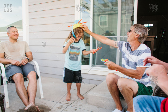 Boy and man laughing on patio