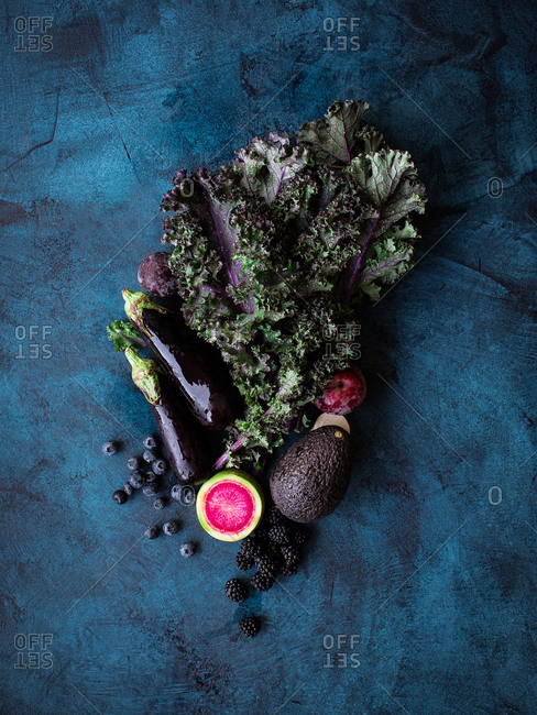 Fruits and vegetables on dark background