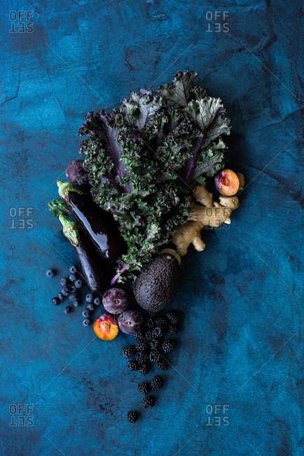 Fruits and veggies on dark background