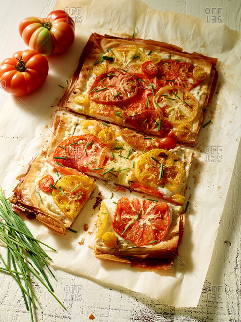 Pizza with heirloom tomatoes and chives