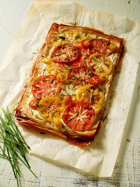 Whole pizza with heirloom tomatoes and chives
