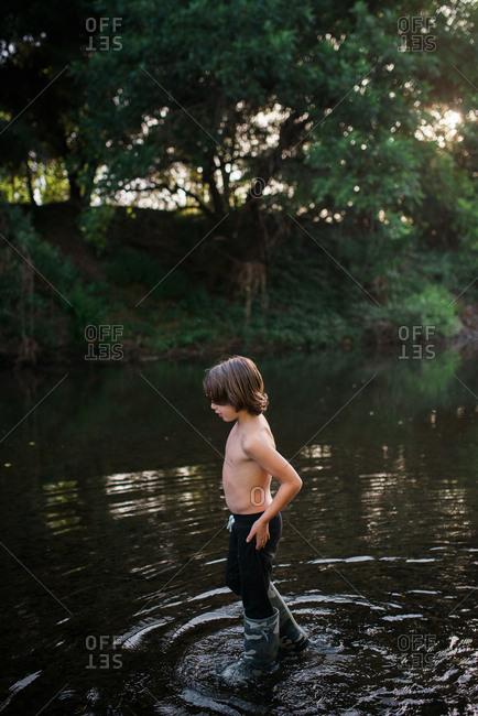 Boy wading into river in Napa Valley