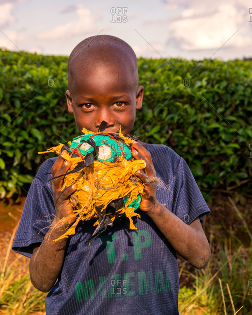 Nairobi, Kenya - April 18, 2015: Boy with a soccer ball made of rags,