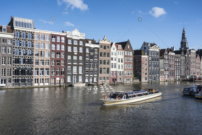 June 9, 2017: Netherlands- Amsterdam- Damrak- row of canal houses