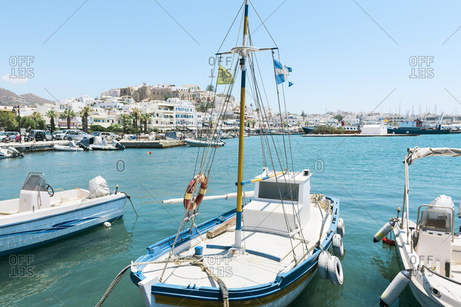 July 8, 2016: Greece- Cyclades- Naxos- boats moored in the port with the city in the background