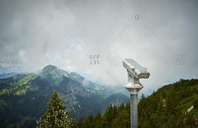 Germany- Chiemgau- binoculars on summit of Hochfelln Mountain with view to Austrian Alps
